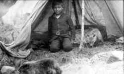 Historic Matachewan FN Photo of a boy and his pets